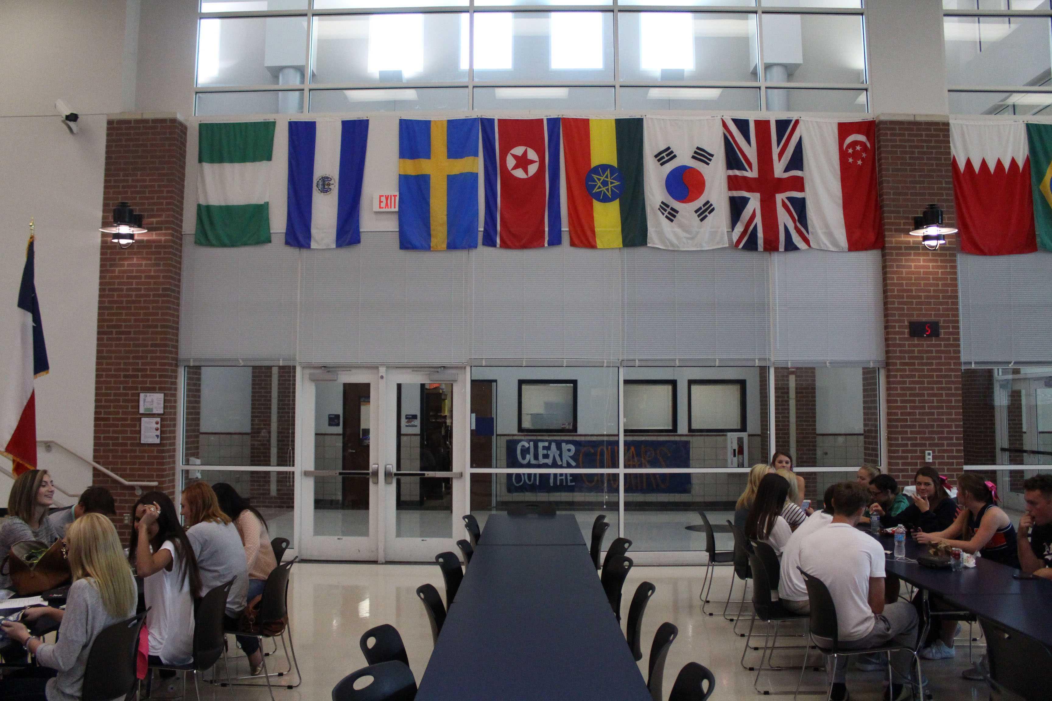 The lunch room's most notable feature is the flags that follow the edges of the room. Countries in the picture include South Korea, Singapore, Ecuador, Nigeria, Bahrain and Ghana