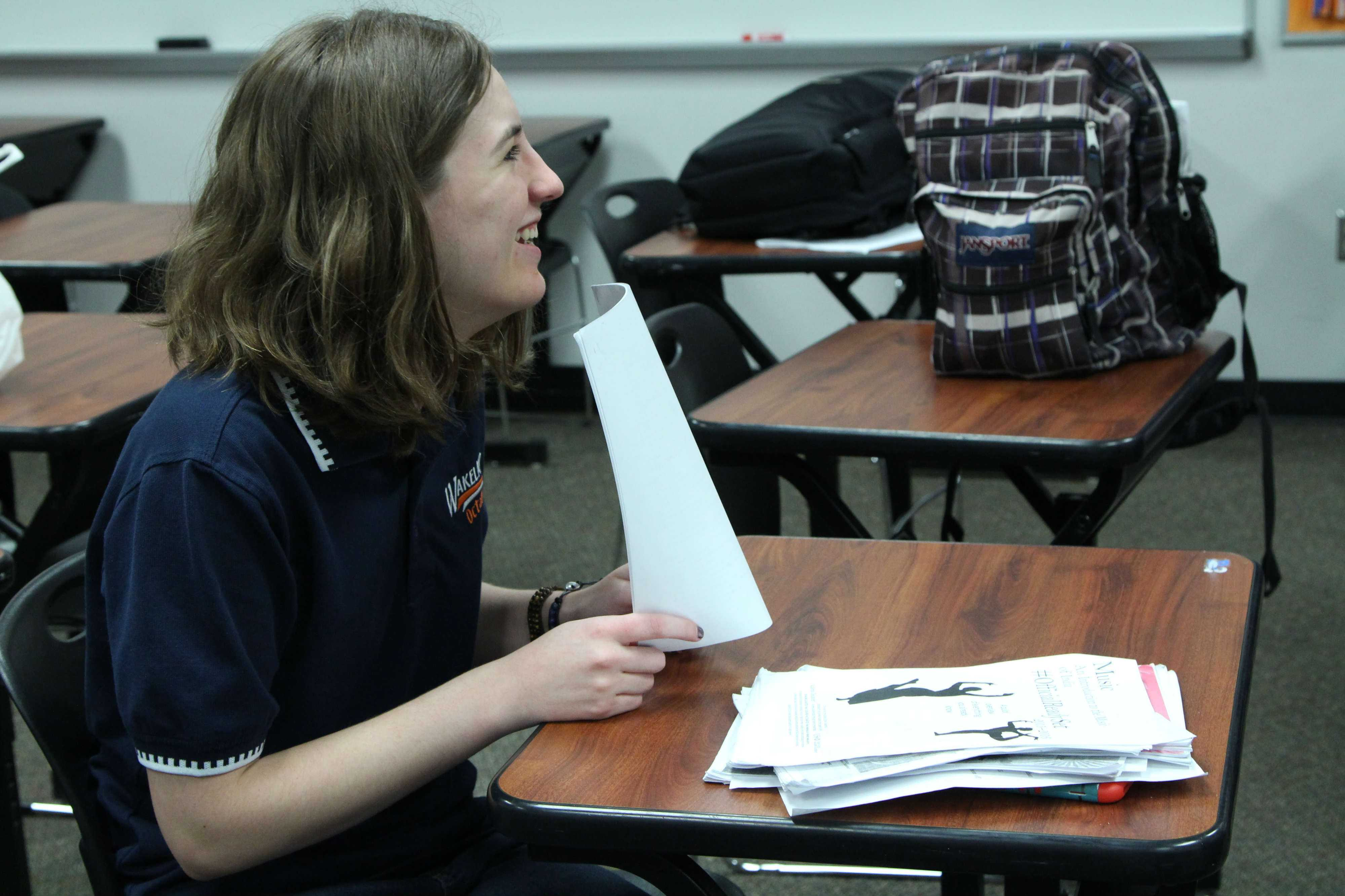 Sophomore Reece Walter laughs at a joke while cramming for her Octathlon test on 