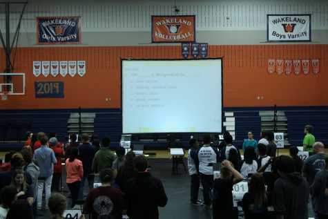 "The Super Quiz took place in the auxiliary gym. At each team post, students had only seconds to talk over and write the answer to a question displayed on the screen that could be from any of the Academic Decathlon subjects. ""Super quiz was challenging, and the tension to see who was winning was palpable. The best part of the experience was having that group effort at the end of a long day that let us celebrate something that we could be all proud of."" Chastain-Howley said."