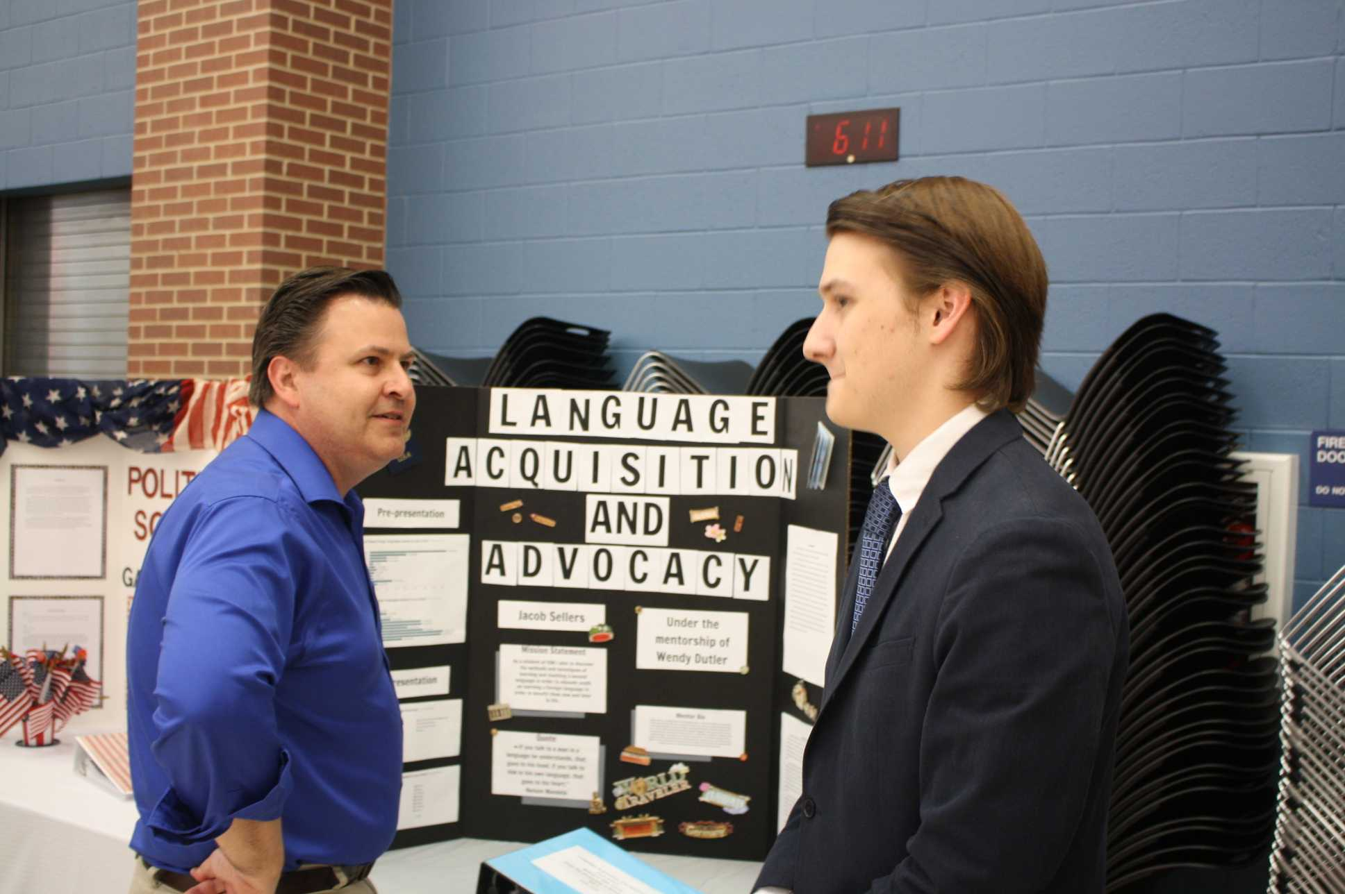 Jacob Sellers presents his study of language acquisition and advocacy with world history teacher John Lane.