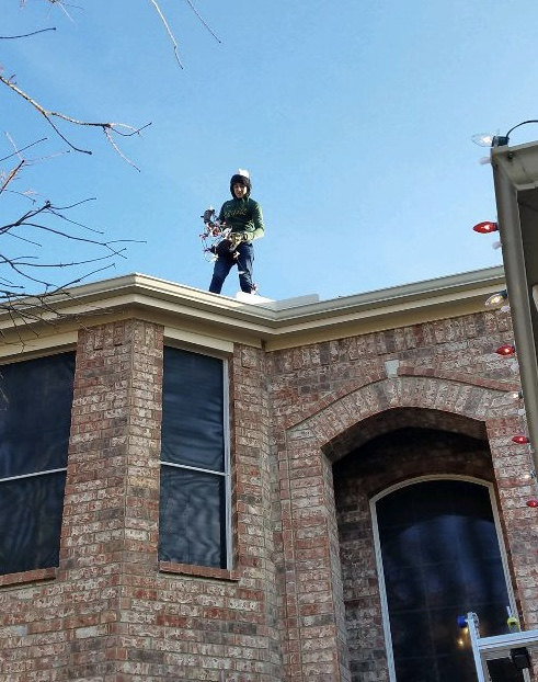 Junior Colton Stovall reaches new heights with his business venture - installing holiday lights!