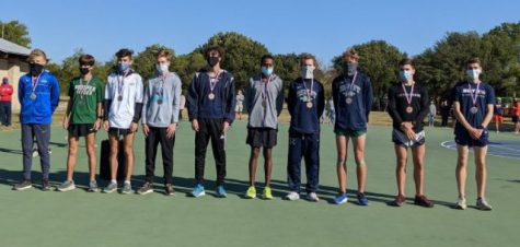 Enright, sixth from left, places eighth in state, breaks school and personal records