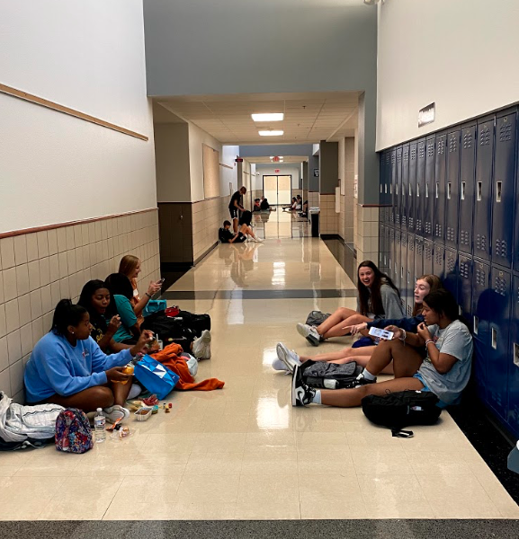 """Food, Friends, and Fun - Students meet in the hallway for lunch. While enjoying their food, they can complete schoolwork, attend tutorials, and club meetings. I feel like future students should be able to experience power lunch because it is a good way to still be with your friends even if you don't have a class with them and you can't utilize your time with tutorials,"""" Smorynski said."""