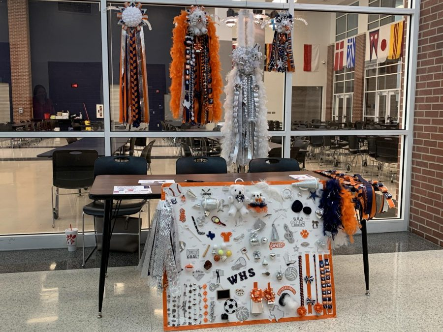 The cheer team sells mums and garters to students so they can easily  design what they want for their date. Wakeland homecoming is Sept. 17, 2021. Photo by Kate Nosel.
